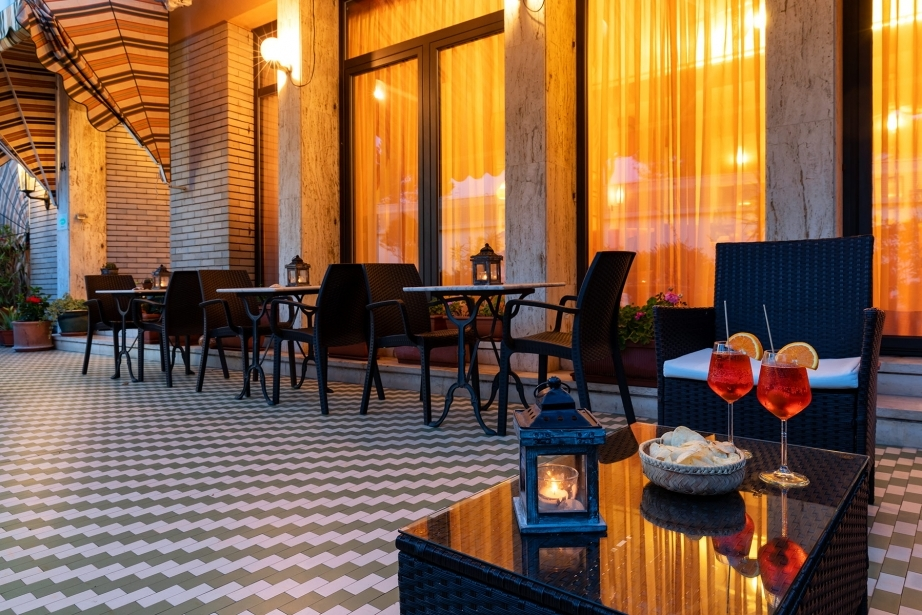 Sip a drink in the lovely dehor of the Hotel Rivamare